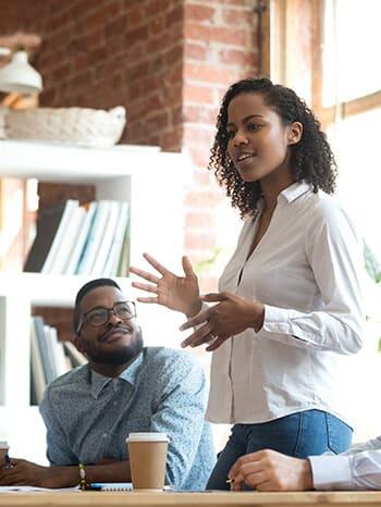 Women_standing_speaking_in_leadership_position