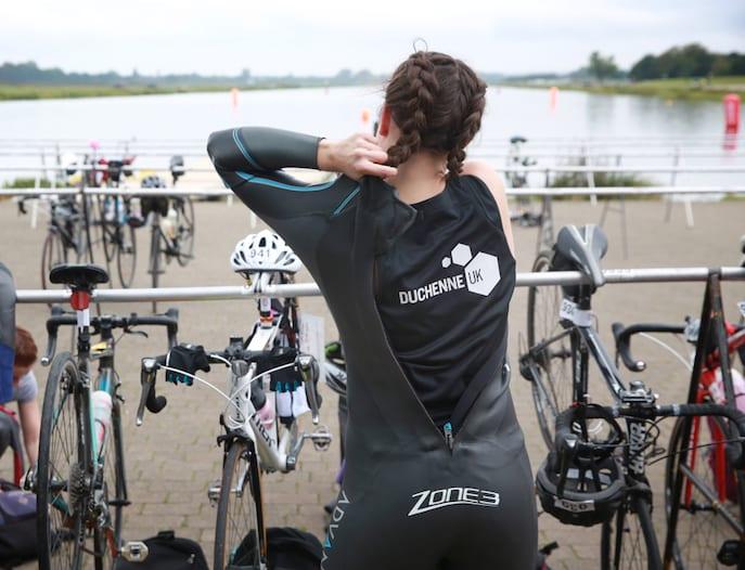 A swimmer taking part in a triathlon for Duchenne UK
