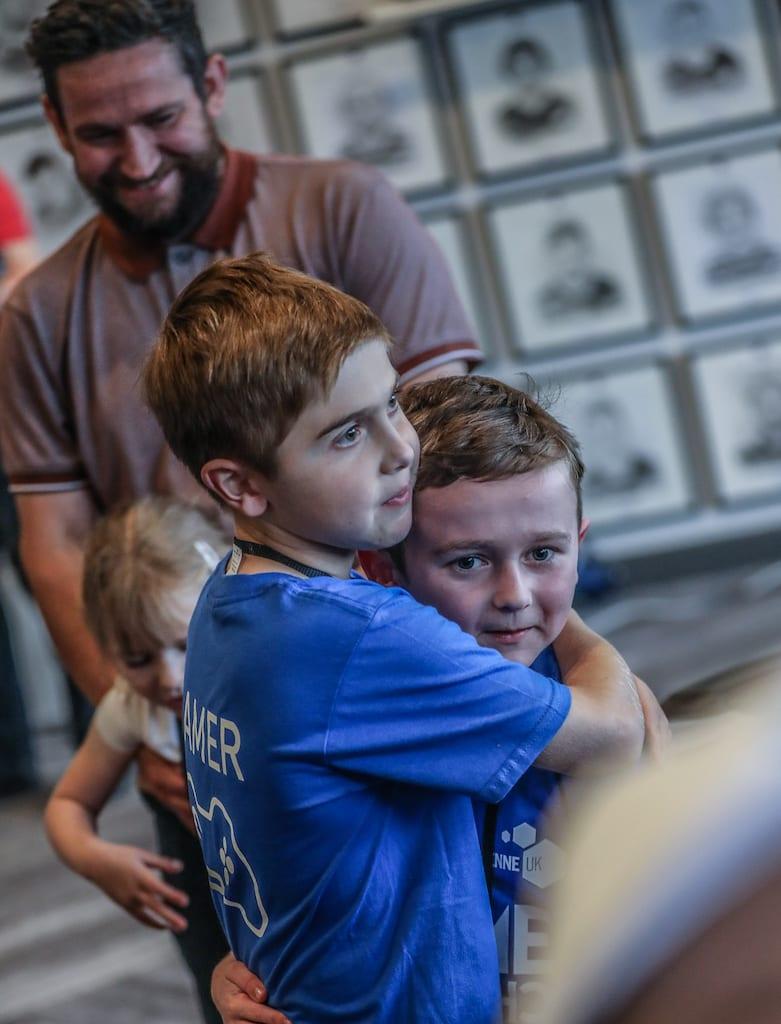 Boys hugging at Duchenne UK gaming day