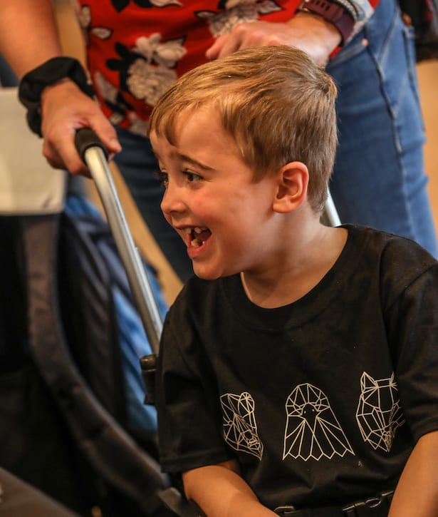 Young boy with DMD in wheelchair