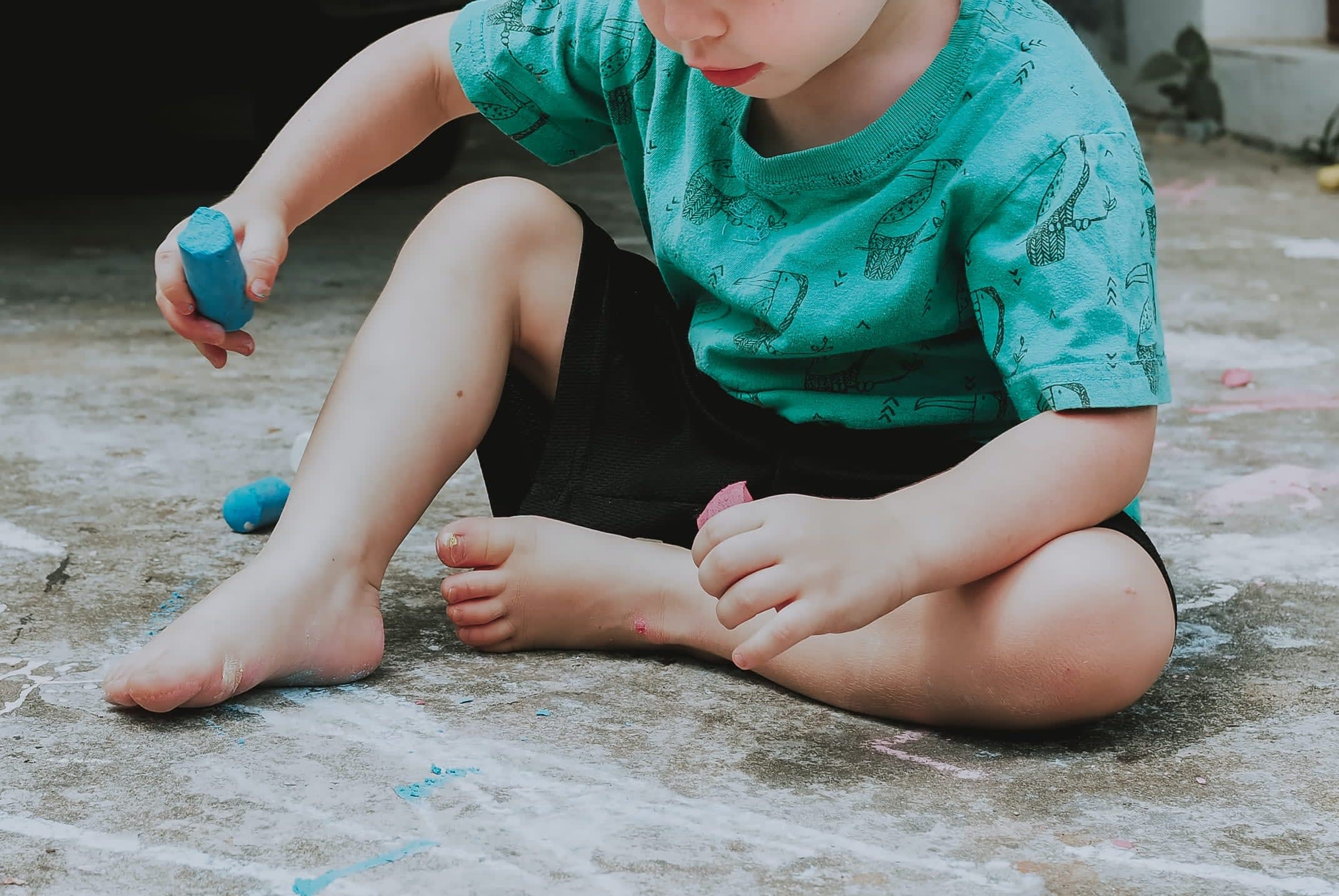 young boy sitting on floor