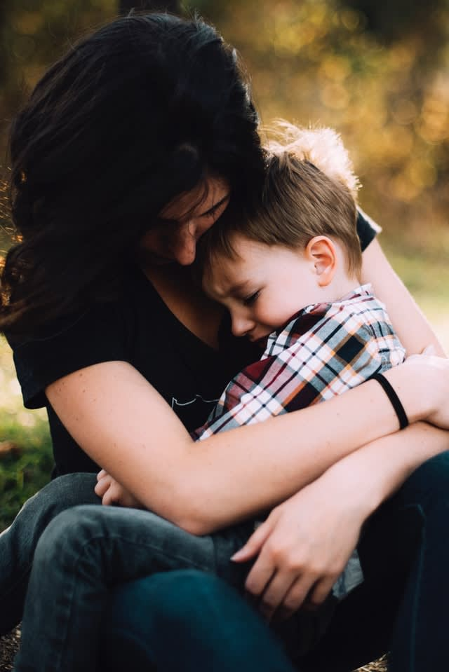 A mother and boy hugging