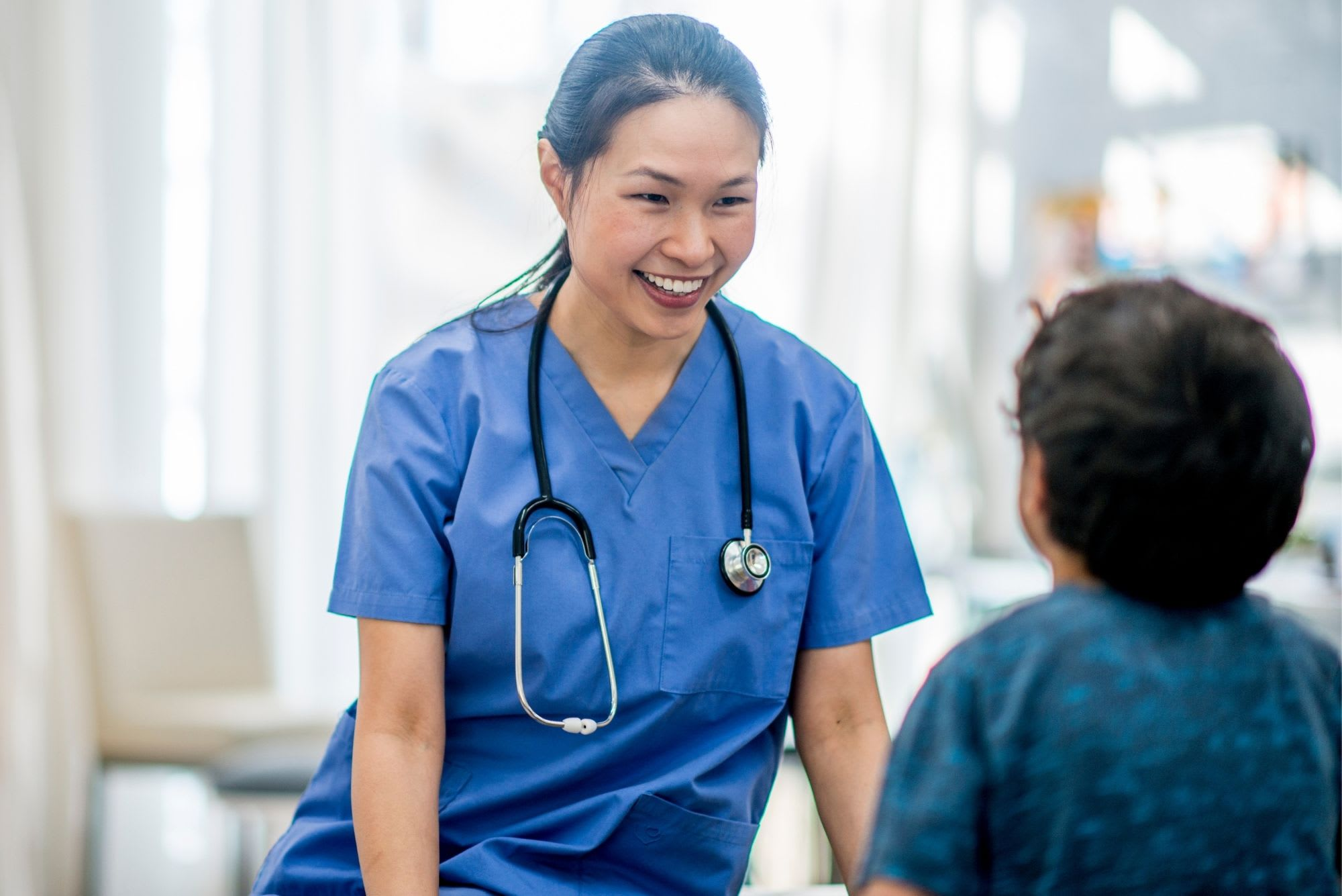 Doctor with young boy