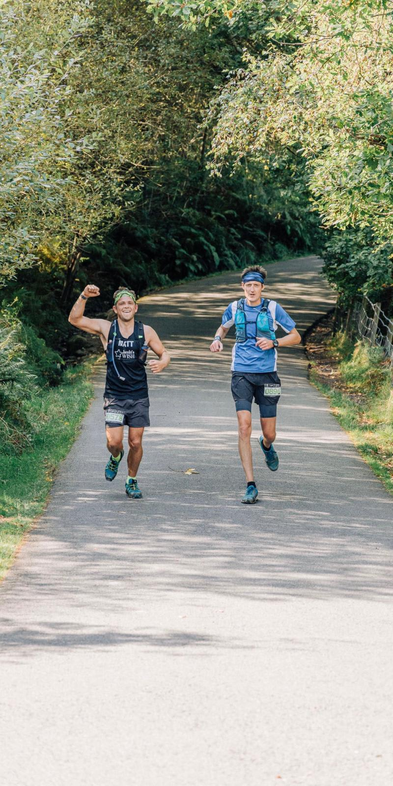 2 Marathon Runners on a country road