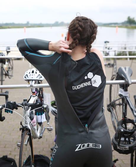 A fundraiser taking part in a triathlon for Duchenne UK