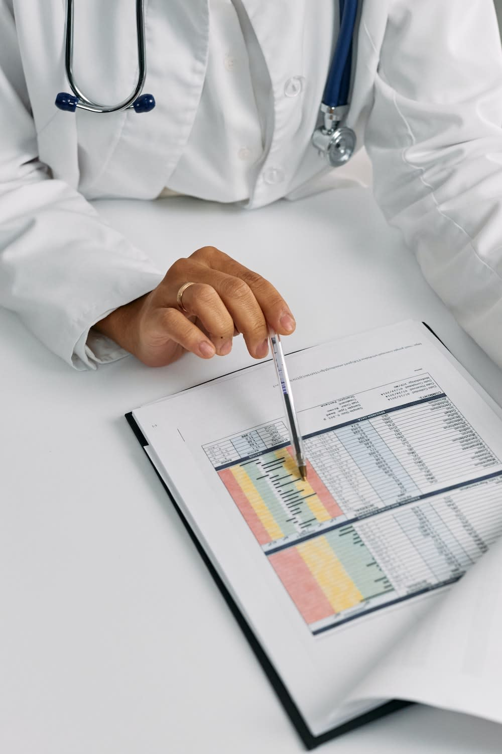 A doctor reading a patient's medical report
