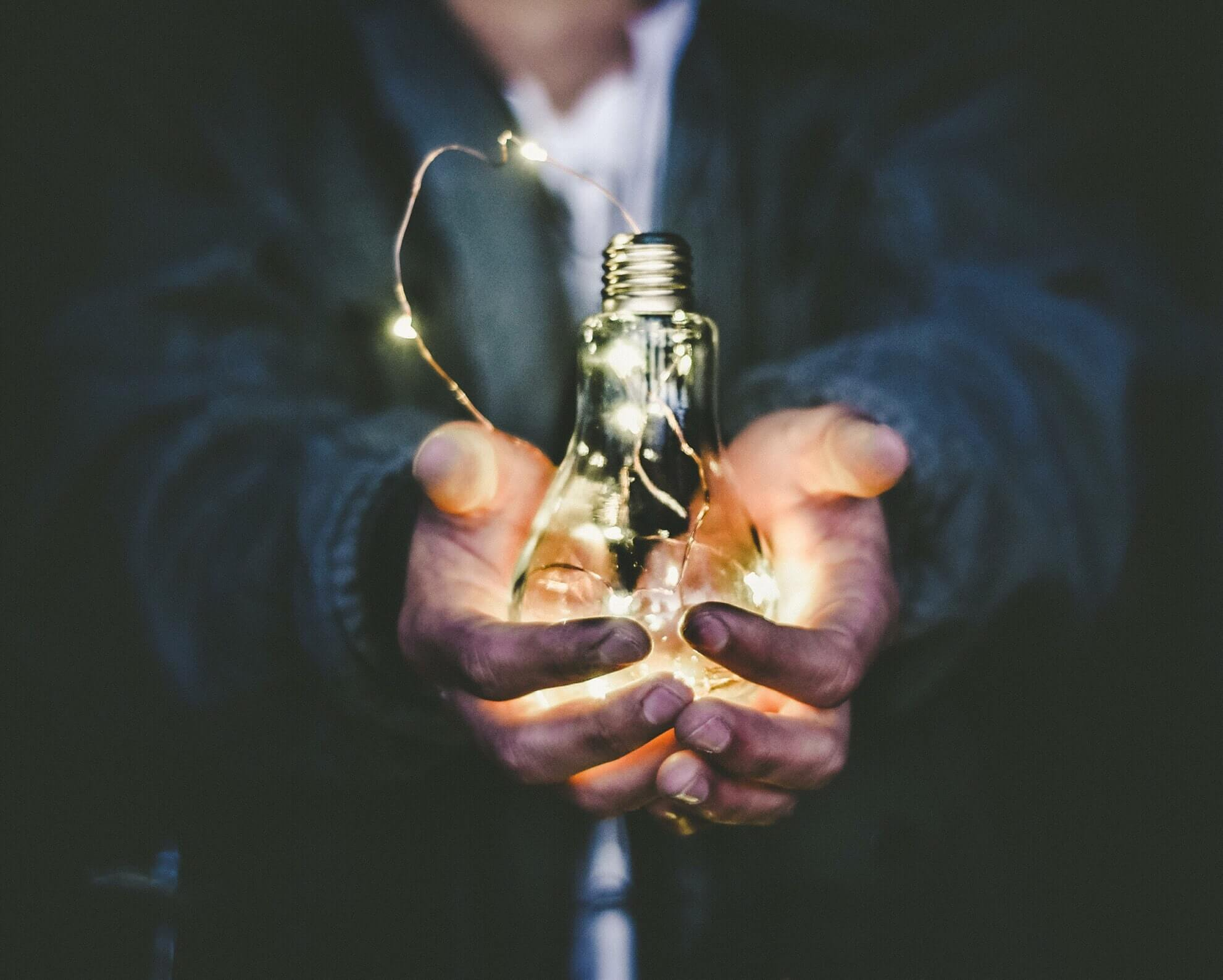 Image_representing_idea_with_lightbulb_in_hand
