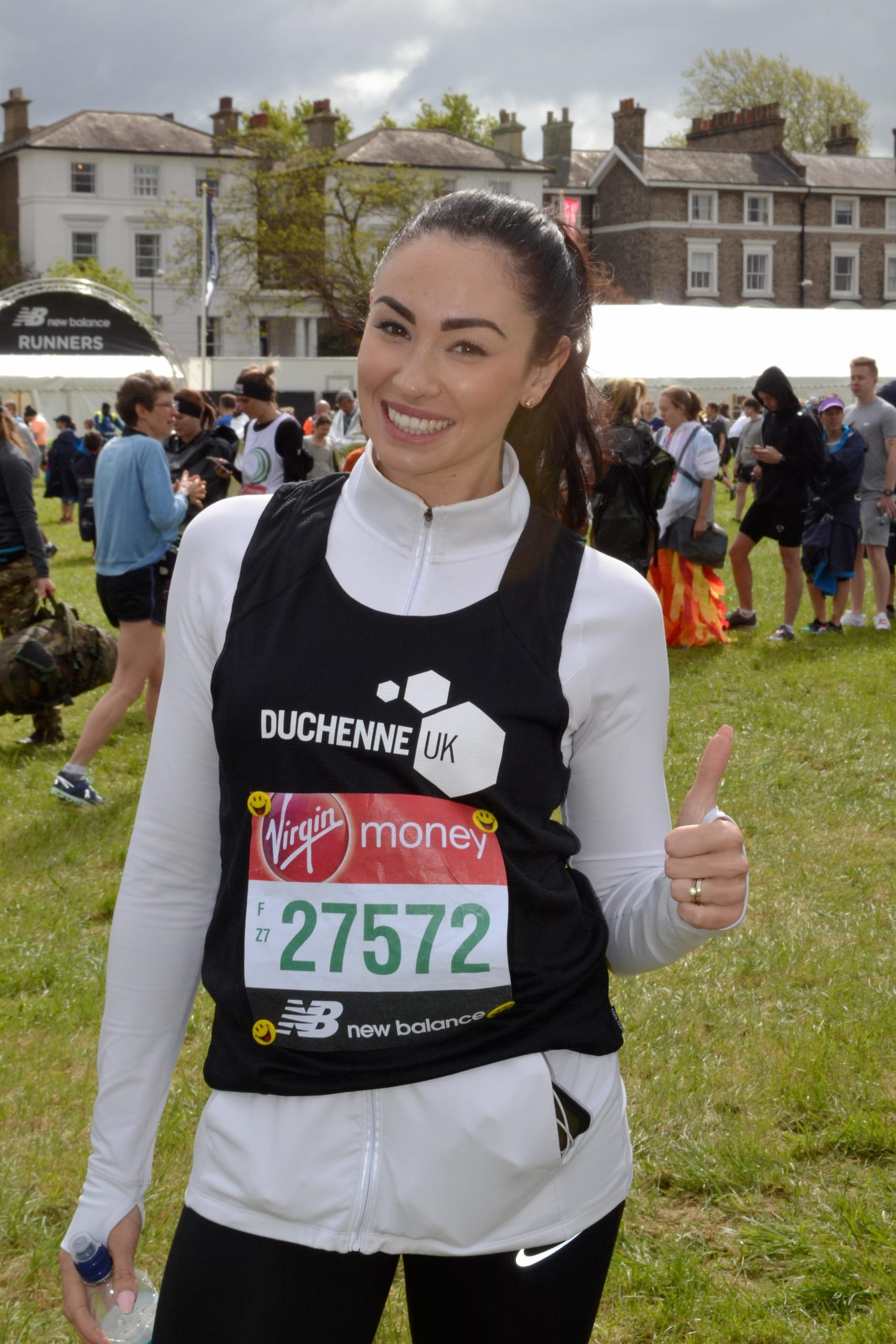Hannah posing with a thumbs up before London Marathon