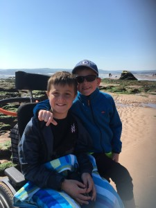 George, who has DMD, with his brother at the beach