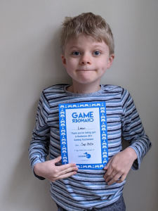 Leon with his Game Changers certificate from the Duchenne UK gaming day