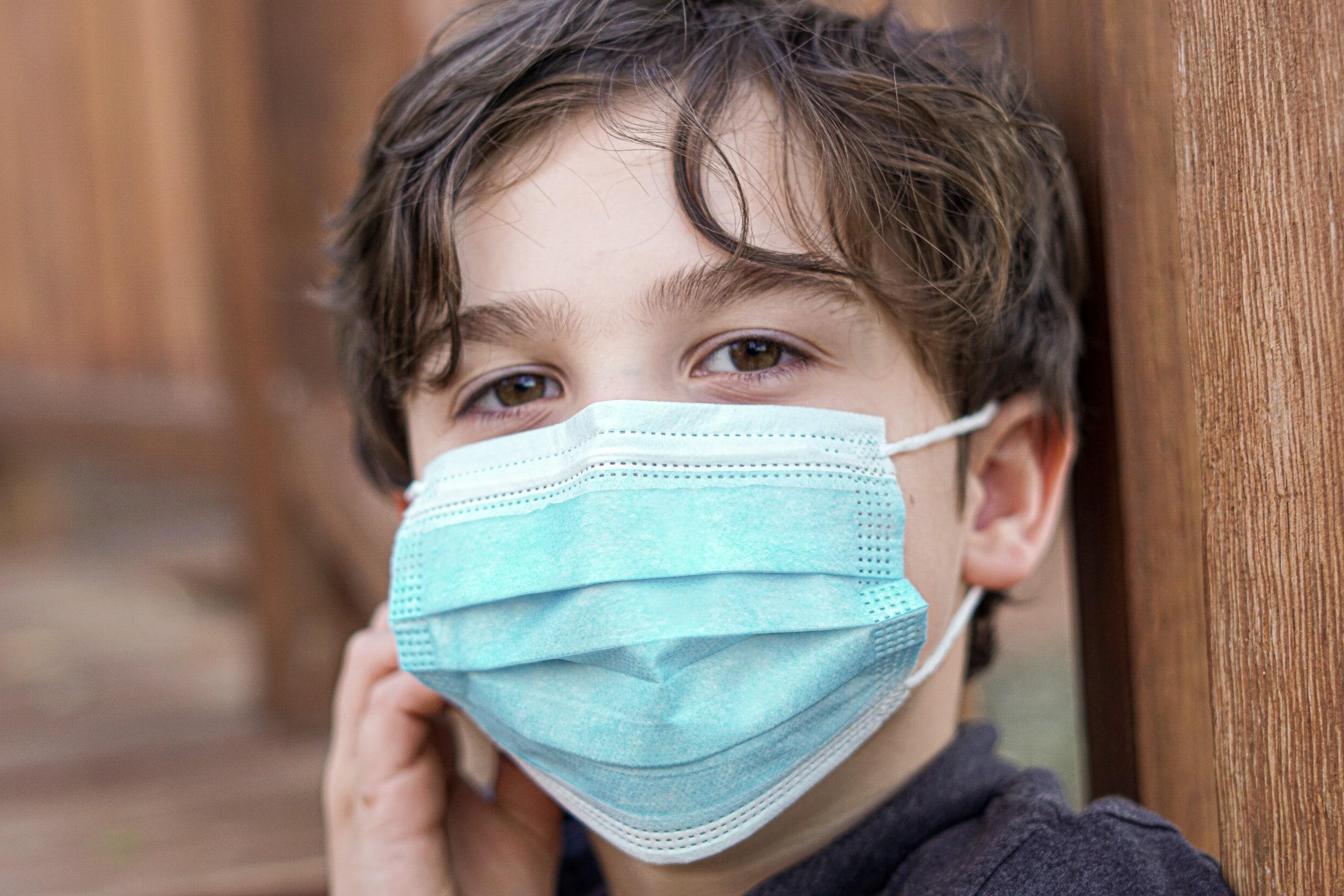 Boy wearing facemask