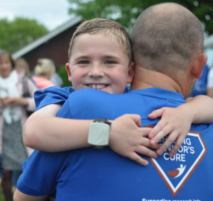 Matt embracing his son Connor, who has DMD