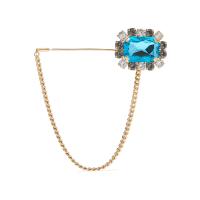 Dolce & GabbanaGoldfarbene Brosche mit Kristallen