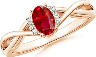 Angara Solitaire Oval Ruby Criss-Cross Ring With Linear Diamond