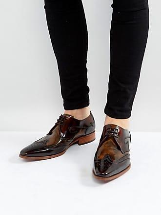 Chaussures derby en cuir poli à bout perforé495.00BOSS