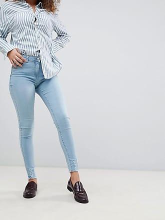 Jean skinny avec déchirures aux genoux et ourlet évasé effet vieilli - NoirParisian