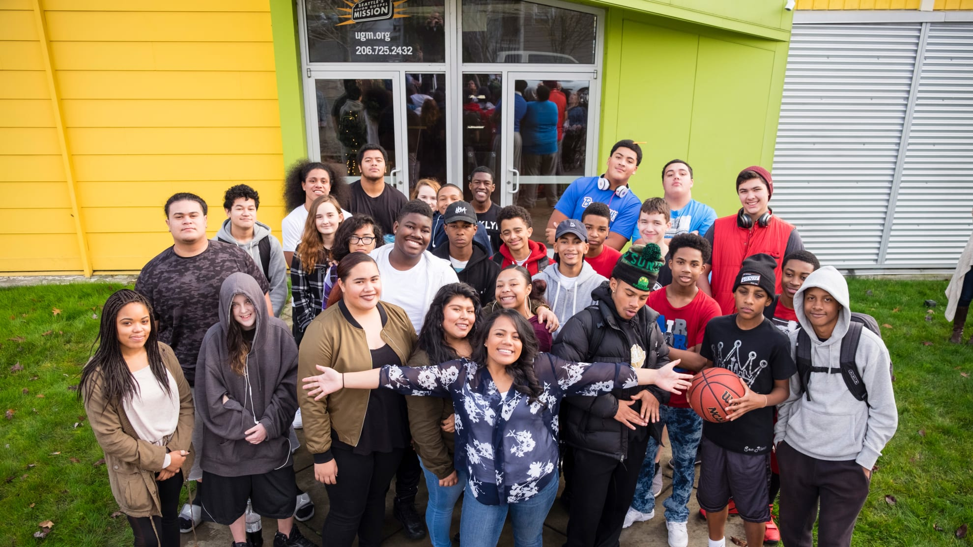 a group of high school students standing in front of Seattle Urban Academy in Rainier Valley