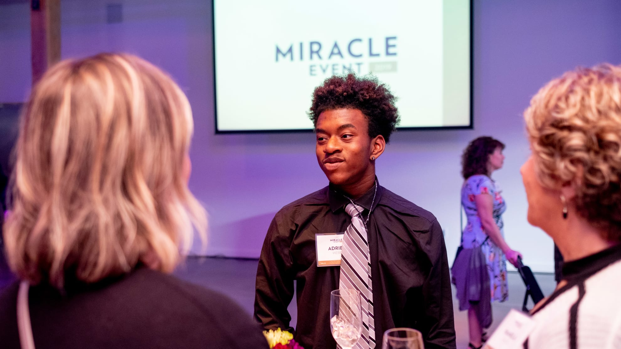 Adriene a student at SUA speaks with Miracle Event Guests