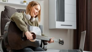 Online Music Student with Guitar