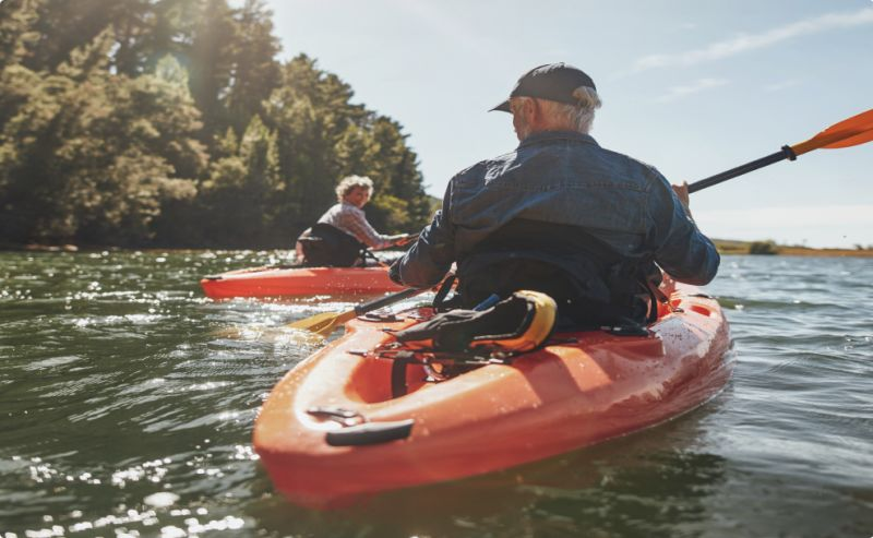 Elderly couple kayaking
