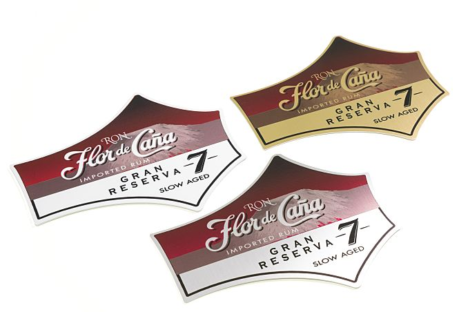 Metal Shelf Talkers can be cut into almost any shape. Shown on gloss white (left) and silver and gold brushed aluminum.