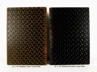 "12"" x 18"" Reddish and 12"" x 18"" Blackened Steel Tread Plate $25 each"