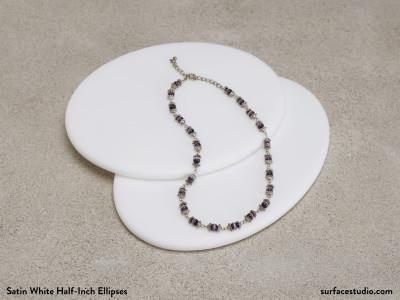 Satin White Half-Inch Ellipses (2) - $40 Each