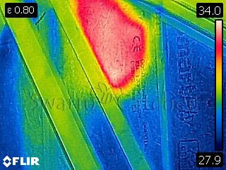 Bees in walls - Thermal image of honey bee colony in loft wall - Barry