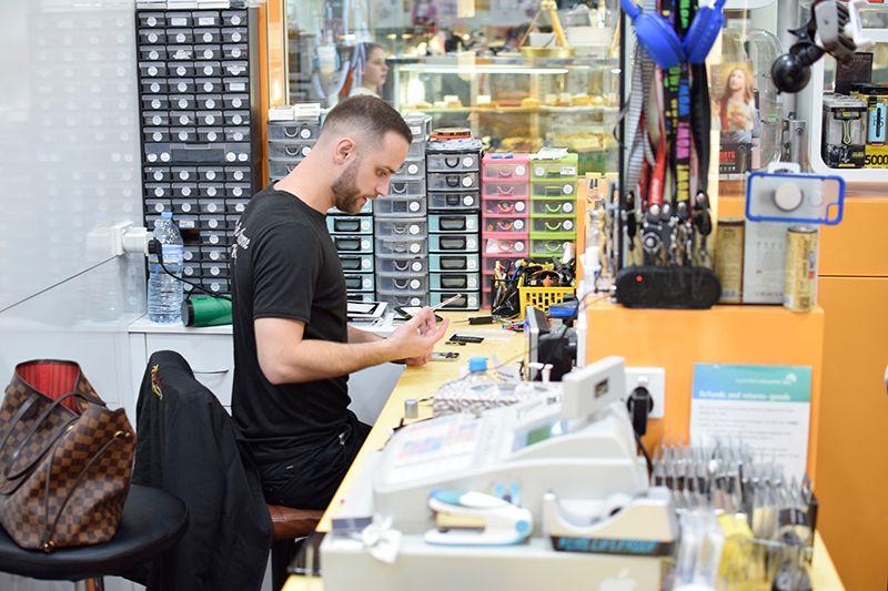 Mobile phone technician repairing a phone