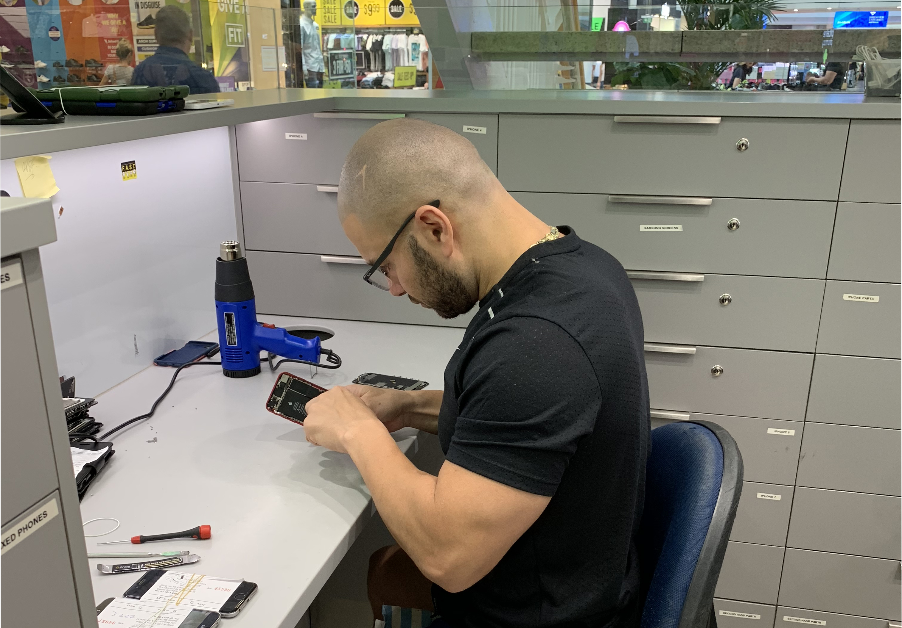 Mobile phone repair technician working