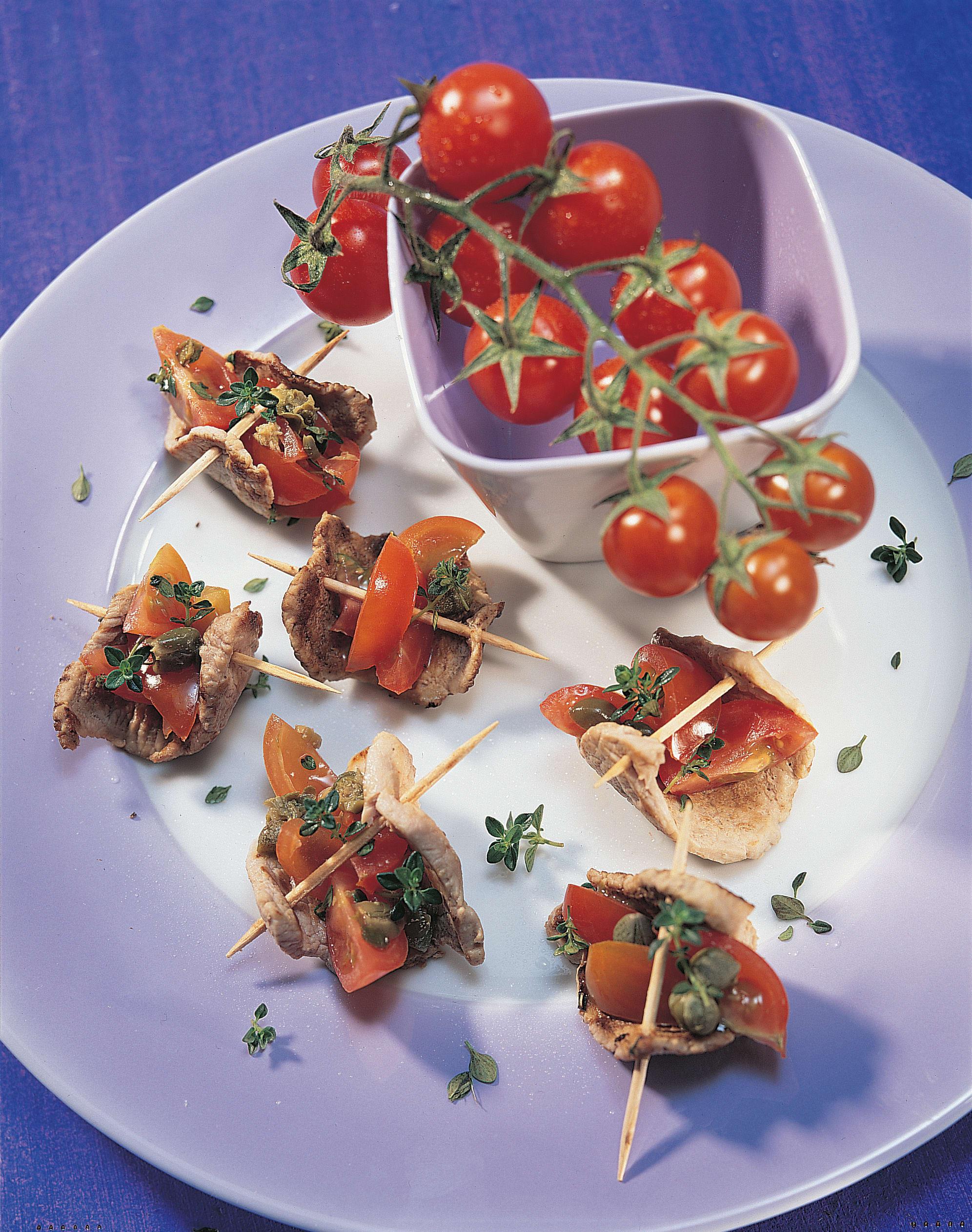 Schweinsplätzchen mit Cherrytomaten-Salat