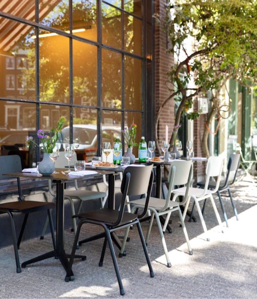 Outdoor tables of Italian food show Amsterdam best terraces for lunch. Article by Table Sage