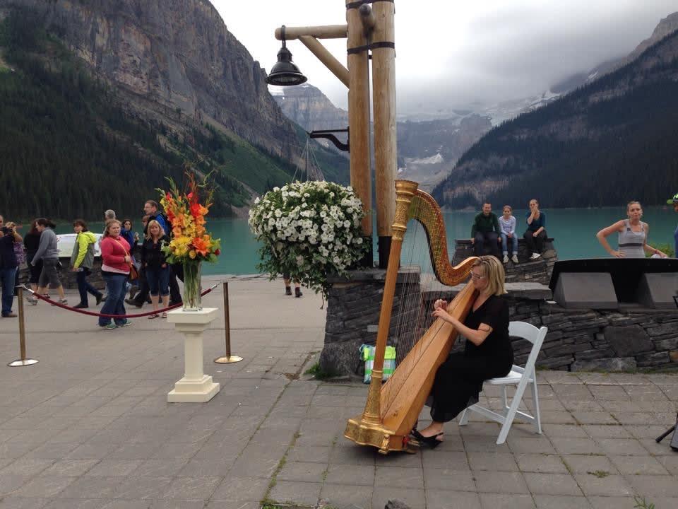 Tiffany playing the harp at Lake Louise.