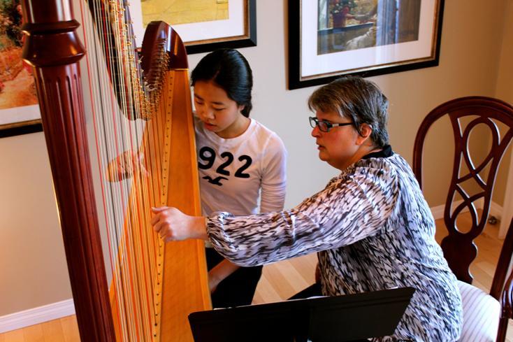 Harp Student Lauren tries the harp.