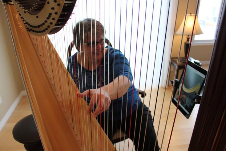 Harp Teacher Tisha demostrates a harp Skype lesson