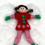 Elf making a snow angel