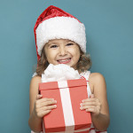 Little girl holding a present