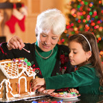 Grandmother and granddaughter gingerbread house