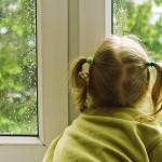 girl looking at rain