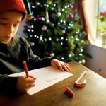 Boy writing letter to santa