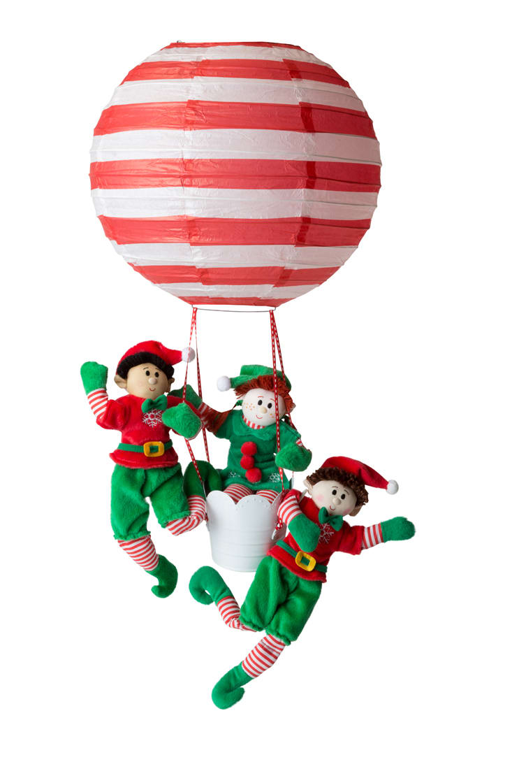Up, Up and Away go the elves in a balloon