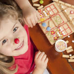 Girl making a gingerbread house