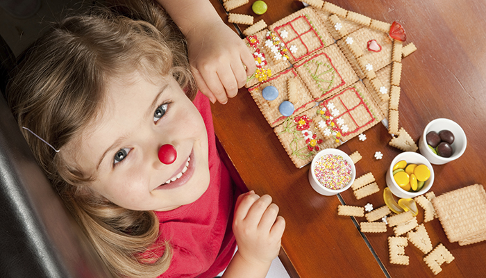 Girl making gingerbread house