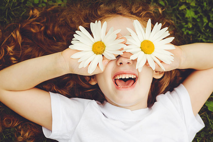 girl with flowers smiling