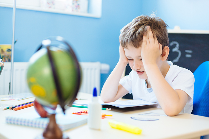 kid frustrated with schoolwork