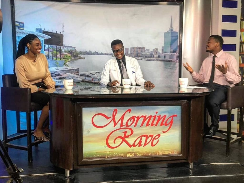 Dr. George The Talk Doctor on the set of his health TV show on Rave TV
