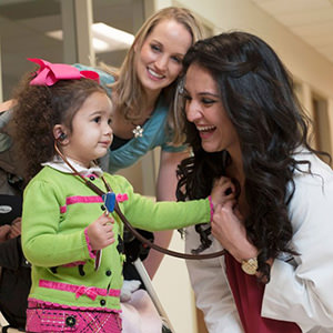 Medical student with child and mother
