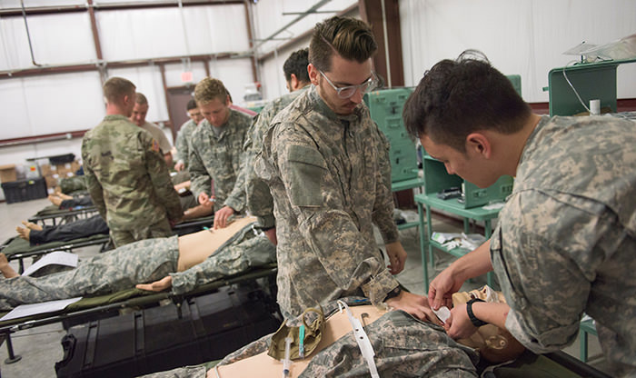 Medical students learning military field medicine