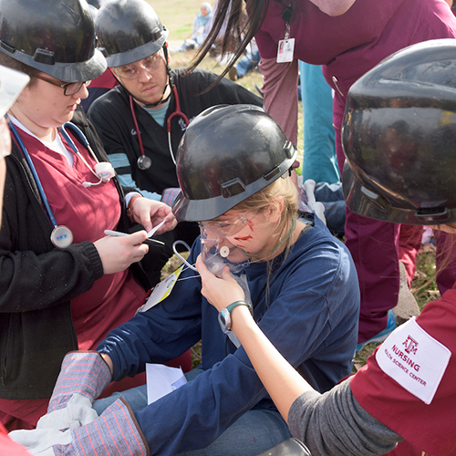 Students administering oxygen to a Disaster Day patient