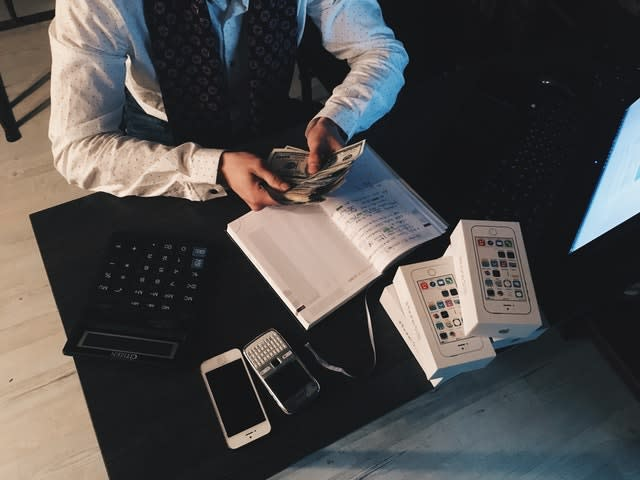 Business owner counting extra money